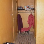 Nice alcove for clothes n suitcases next to large bathroom with sink, toilet and large shower ar
