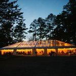 Night photo of a tented wedding reception