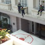 local firemen doing a safety evacuation drill from the hotel rooms