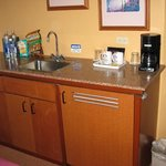 Nice wet bar with fridge and coffee maker in Living Room