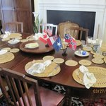  Dining table with fine food and cloth napkins in rings