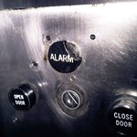  Burnt and melted lift alarm button