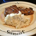 Steak with mashed potatoes.