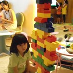 An in-house KID Zone guest playing with LEGO soft