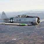 Make a tax deductible donation and fly in our WWII T6/SNJ