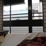 While resting on the comfortable futon-bed I was able to look at the Kyoto Station. I was so hap