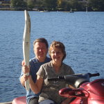 Hosts at Long Lake B&B with Olympic torch