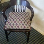  this is the easy chair in Millenium rooms--an old desk chair and pillow