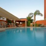  Relax by the pool after a spring training game or shopping
