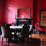 The sumptuous red dining room