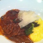 Lamb ragout with polenta and kale.