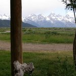  View of Tetons and road in front of cabin