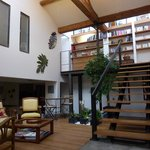 Loft Evasion atrium and staircase leading to mezzanine floor.