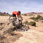 Practicing technical descents on trail with Moab Mountain Bike Instruction