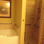  Two bathrooms have soaking jacuzzi tubs and roll in shower in handicapped room