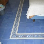 Tile on floor surrounded bed