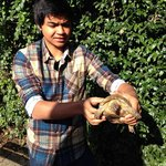  Son and tortoise. Tortoise looks happier.