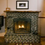 All rooms feature beach rock fireplaces.
