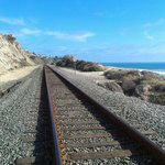 train tracks next to the beach