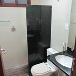 very small bathroom, open stall
