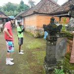  Our guide explaining a typic Balinese family house layout.