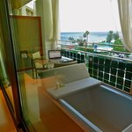 The balcony with the bathtub.