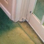 corroded door jam leading to pool/ stained carpet left side