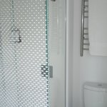 Shower, toilet and towel warming rack.