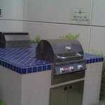 The outdoor gas BBQ's by the pool