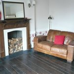  A nice leather settee to relax in - no matches to light the fire though! (room 3)