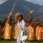 one of the young dancers with volcanoes behind