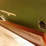 Headboard pulled from wall and hole in wall