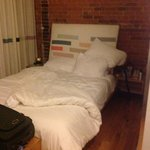 "The double bed in ""Refresh"", Room 312."