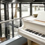 Piano, overlooking the River Grille restaurant