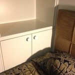 single bed (in a deluxe king bed room) up against a cupboard??