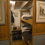  Cabins are rustic and fitting of a mid-1800&#39;s style windjammer