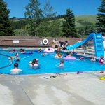 outdoor heated pool with kids slide