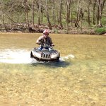 Terry crossing the creek at Triple G Atv Rides