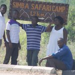 At the signpost to Simba Safari camp with a couple of friends