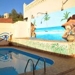 Our swimming pool, with murals by a local artist