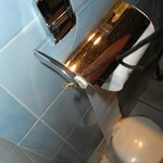 Provisory repaired bathroom tissue holder