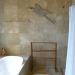  Towel rack, shower to right, bath tub to left, and window with venetian blinds that needed fixin