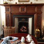 A welcoming fire and tea and biscuits in the sitting room