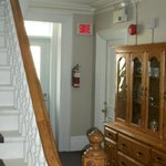 Old staircase to third floor and beautiful bookcase
