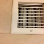 dirty air vent in bathroom
