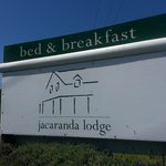 Jacaranda Lodge sign at the main road