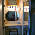 Tucked away vanity in hallway (clever use of space).