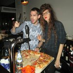 The sassy maitre d' and stern sommelier serve up some pizza-y lagniappe