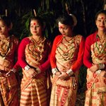 Assamese dancing troupe outside bungalow