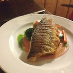 Pan fried sea bass, swede fondant, potato hash, poached rhubarb, ginger & rhubarb purée